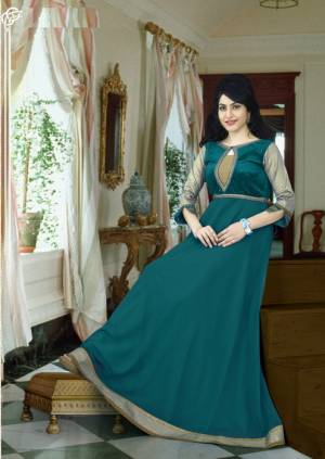 Look Beautiful In This Pine Green Colored Gown Fabricated On Georgette. This Gown Is Light In Weight And Also It Is Durable. Pair This Beautiful Floor Length Gown With Elegant Earrings And Complete The Look.