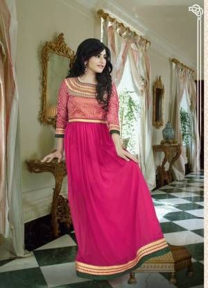Doll Up In This Rani Pink Colored Gown With A Very Pretty Braso Fabricated Yoke Pattern.  This Pretty Floor Length Gown Is Fabricated On Georgette Which Is Soft Towards Skin And Light In Weight. Buy This Gown Now.