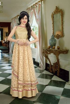 Simple And Elegant  This Beige Colored Gown Fabricated On Georgette. It It Light In Weight With A Very Unique Pattern. You Will Definitely Earn Lots Of Compliments Wearing This Pretty Gown. Buy Now.