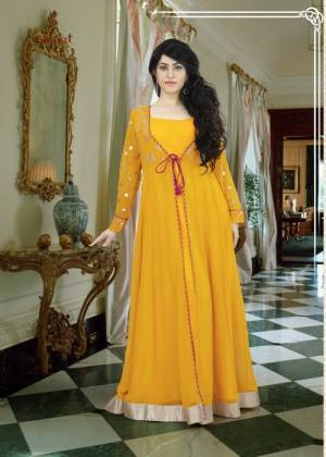 Quite A Different Color To Add Up To Your Wardrobe This Summer. Grab This Musturd Yellow Colored Floor Length Gown With Jacket Styled Pattern. This gown Is Fabricated On Georgette Which Is Light In Weight and Comfortable To Carry All Day Long.