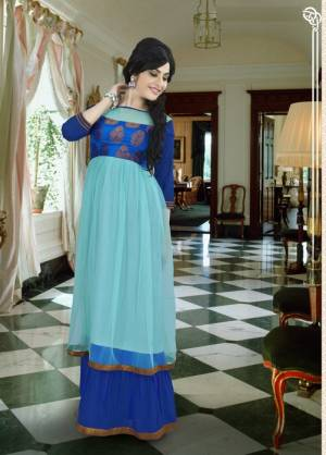 Go With The Hues Of Blue This Season With This Aqua Blue And Royal Blue Colored Gown. This Gown Is Uniquely Patterned In Two Layered Fabricated On Georgette. It Is Durable And Easy To Care For. Buy It Now.