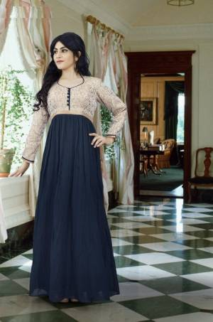 Flaunt Your Rich Taste With This Sophisticated Colored Combination In Gown. This Dark Grey And Beige Colored Gown Will Make You Look The Prettiest Of All And It Will Earn You Lots Of Compliments. Buy Now.