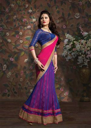 Grab This Beautiful Blue Colored Lehenga Choli Paired With Cntrasting Pink Colored Dupatta. Its Blouse Is Fabricated On Brocade Paired With Net And Brocade Fabricated Lehenga And Chiffon Dupatta.