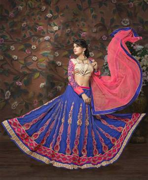 For A Heavy Look, Grab This Lovely Lehenga In Beige Colored Blouse Paired With Blue Colored Lehenga And Pink Colored Dupatta. Its Blouse Is Fabricated On  Art Silk Paired With Net Fabricated Lehenga And Dupatta. It Is Easy To Carry All Day Long. Buy Now.