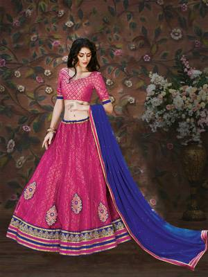 Shine Bright With This Pink Colored Lehenga Choli Paired With Blue Colored Dupatta. Its Blouse Is Fabricated On Brocade Paired With Net And Brocade Fabricated Lehenga With Chiffon Dupatta. Buy This Pretty Lehenga Now.