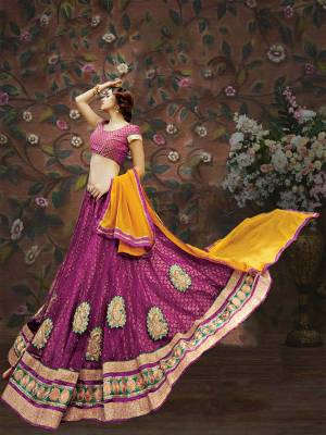 Bright And Visually Appealing, Here Is A Pretty Magenta Pink Colored Lehenga Choli Paired With Contrasting Yellow Colored Dupatta. Its Blouse Is Fabricated On Brocade Paired With Net And Brocade Fabricated Lehenga And Chiffon Dupatta. All Fabrics Ensures Great Comfort Throughout The Gala. Buy Now.