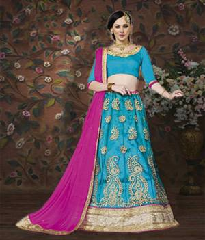 Look Beautiful In This Turquoise Blue Colored Lehenga Choli Paired With Contrasting Rani Pink Colored Dupatta. This Lehenga Choli Will Definitely Earn You Lots Of Compliments From Onlookers. Buy Now.