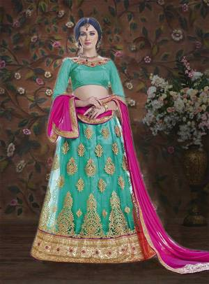 This Wedding Season Get The Traditonal Look On Yourself With This Lovely Sea Green Colored Lehenga Choli Paired With Contrasting Rani Pink Colored Blouse. Its Blouse Is Fabricated On Art Silk Paired With Net Fabricated Lehenga And Chiffn Dupatta. Buy It Now.