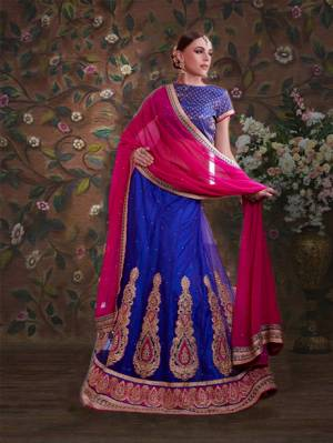 Bright And Visually Appealing, Here Is A Pretty Royal Blue Colored Lehenga Choli Paired With Contrasting Dark Pink Colored Dupatta. Its Blouse Is Fabricated On Brocade Paired With Net Fabricated Lehenga And Chiffon Dupatta. All Fabrics Ensures Great Comfort Throughout The Gala. Buy Now.
