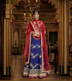 Get Ready For The Next Wedding At Your Place With This Beautiful Lehenga Choli. Its Red Colored Blouse Is Paired With Blue Colored Lehenga And Red Colored Dupatta. This Pretty Lehenga Choli Is Fabricated On Art Silk And Net Fabricated Dupatta. Grab This Designer Lehenga Choli Now.