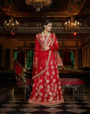 You Will Certainly Steal All The Limelight From From The Bride At The Next Wedding You Attend Wearing This Birght And Beautiful Lehenga Choli. This Red Colored Designer Lehenga Choli Is Fabricated On Art Silk With Net Fabricated Dupatta. This Lehenga Choli Is Easy To Carry Throughout The Gala. Buy It Now.
