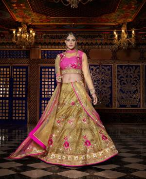 Look Beautiful In This Designer Lehenga Choli In Dark Pink Colored Blouse Paired With Beige Colored Lehenga And Dupatta. This Lehenga Choli Is Fabricated On Art Silk Paired With Net Dupatta And Beautified With Heavy Floral Embroidery All Over. Buy This Lehenga Choli Now.