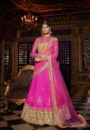 Flaunt Your Pretty Ethnic Side With This All Over Pink Colored Lehenga Choli. Its Designer Blouse Is Fabricated On Art Silk And Net Paired With Art Silk Fabricated Lehenga And Net Fabricated Dupatta . Pair This Up with A Maang Tika For A Complete Ethnic Look. Buy This Lehenga Choli Now.