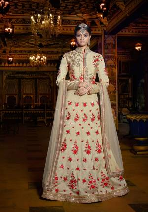 Sophisticated And Elegant, This Beige Colored Lehenga Choli Will Definitely Earn You Lot Of Compliments From Onlookers. This Designer Lehenga Choli Is Fabricated On Art Silk Paired With Net Fabricated Dupatta. It Is Beautified With Contratsing Colored Embroidery All Over Making The Lehenga Attractive. Buy It Now Before The Stock Ends.