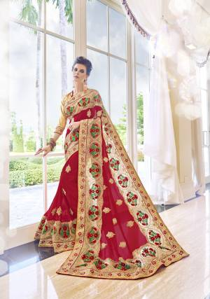 Drape This Red And Golden Colored Saree And Look Pretty Like Never Before. This Beautiful Saree Features Georgette And Heavy Worke  Border , Which Makes It A Smart Pick For Festive Occasions.This Saree Attains A Spotting Personality Through Its Amazing Design And Color Combination. Grab It Now.