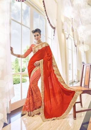 You Will Definitely Steal The Show, Wearing This Red And Orange Colored Saree. Made From Art SIlk And Net, This Saree Will Stay Very Soft Against Your Skin. Featuring An Attractive Embroidery , Zari Border And Fancy Pattern, This Saree Can Be Worn With Matching Accessories For A Beautiful Look. Wear It Now