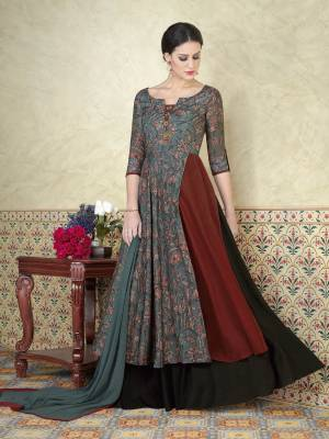 Grab This Pretty Salwar Kameez In Light Teal Blue And Rust Color Paired With  Black Colored Bottom And  Light Teal Blue Colored Dupatta. Its Top Are Fabricated On Tussar Silk Paired With Santoon Bottom And  Chiffon Dupatta.This Lovely  Suit Just For You.Buy This Amazing Suit Now.