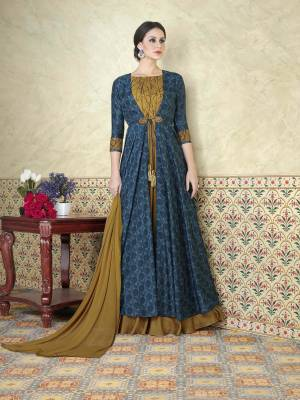 Drape This Steel Blue , Dark Beige Colored Salwar Kameez And Look Pretty Like Never Before. This Beautiful Suits Features A Tussar Silk Paired With Satin Bottom And Chiffon Dupatta.This stylish suit specially for you.Get It Now.