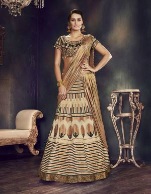 Be a cocktail mix of quirky , classy and stylish at the same time in this black, gold and cream lehenga saree . Go for bold jewelry piece to look striking.