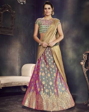 Be an inimitable traditional diva in this dual-tone weaved silk lehenga saree and look majestic as ever.
