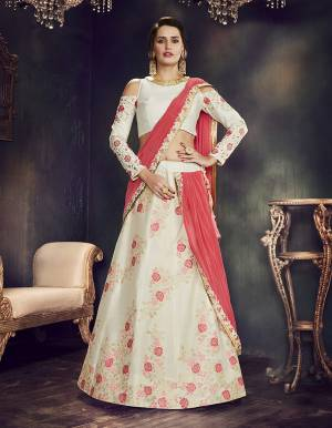 Team this white lehenga adorned with floral weaves and embroideries along with traditional meenakari jewels as look fresh as dew on your special day.