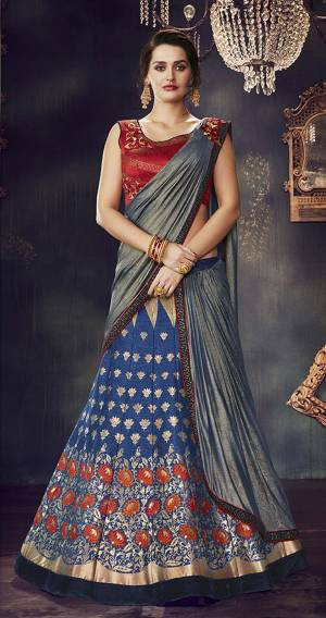 Look gorgeous in this blue lehenga-saree weaved with lotus motifs in threads of gold and shine through the night like a diva.