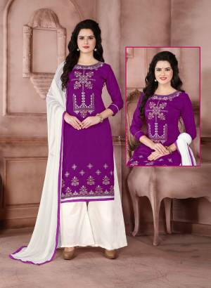 Here Is A Simple Dress Material For Your Casual wear In Purple color Paired With White Colored Bottom And Dupatta. Its Top Is Fabricated On Cambric Cotton Paired With Cotton Bottom And Chiffon Dupatta. It Has Simple Thread Embroidery Over the Top. Buy It Now.