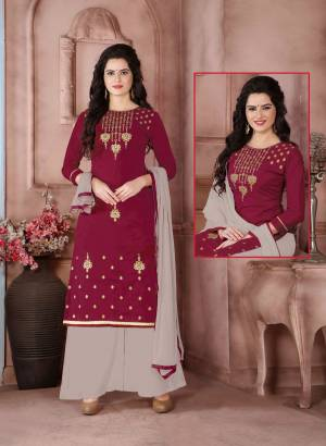 Rich And Elegant Combination Is Here With This Straight Cut Suit In Magenta Pink Color Paired With Grey Colored Bottom Aand Dupatta. Its Top Is Fabricated On Cambric Cotton Paired With Cotton Bottom And Chiffon Dupatta. Get This Dress Material Stitched As Per Your Desired Fit And Comfort. Buy Now.