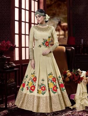 Fashion Keeps On Changing And So Do You, So Go With the Lastest Tredn With This Designer Floor Length Suit In Cream Colore Paired With Cream Colored Bottom And Dupatta. Its Top Is Fabricated On Art Silk Paired With Santoon Bottom And Chiffon Dupatta. It Has Contrasting Colored Embroidery Which Is Making It More Attractive.