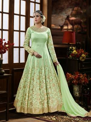 Here Is A Beautiful Shade Of Green With This Designer Floor Length Suit In Pastel Green Color Paired With Pastel Green Colored Bottom And Dupatta. It Is Beautified With Heavy Jari Embroidery And Stone Work. It Ensures Superb Comfort Throughout The Gala. Buy Now.