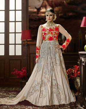 Here Is A Rich And Elegant Looking Floor Length Designer Suit In Grey Color Paired With Grey Colored Bottom And Dupatta. Its Top Is Fabricated On Art Silk Paired With Santoon Bottom And Chiffon Dupatta. It Has Tone To Tone Embroidery And Attractive Embroidery With Contrasting Red Color. Buy This Designer Suit Now.