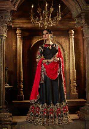 Enhance Your Beauty Wearing This Black Colored Lehenga Choli Paired With Red Colored Dupatta. This Lehenga Choli Is Fabricated On Art Silk Paired With Satin Fabricated Dupatta. It Is Beautified With Attractive Embroidery Over The Blouse And Lehenga. Buy This Designer Lehenga Choli Now.