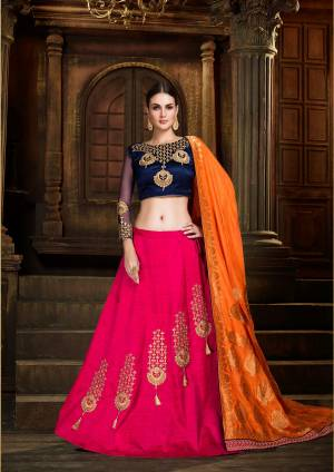 Go Colorful Wearing This Lehenga Choli In Navy Blue Colored Blouse Paired With Dark Pink Colored Lehenga And Contrasting Orange Colored Dupatta. Its Blouse And Lehenga Are Fabricated On Art Silk Paired With Silk Jacquard Fabricated Dupatta. Its Fabrics Gives A Rich To Your Personality Which Will earn You Lots Of Compliments From Onlookers.