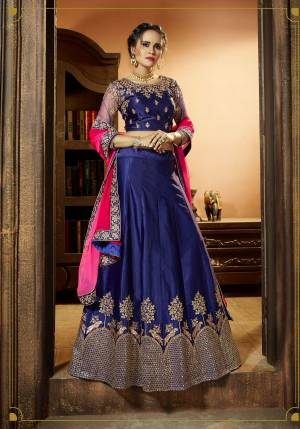 Shine Bright At The Next Wedding You Attend Wearing This Lehenga Choli In Blue Color Paired With Contrasting Rani Pink Colored Dupatta. Its Blouse Is Fabricated On Art Silk Paired With Satin Silk Lehenga And Chiffon Dupatta. It Is Light In Weight And Easy To Carry All Day Long.