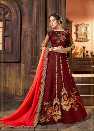 Flaunt Your Rich Taste Wearing This Lehenga Choli In Maroon Color Paired With Pink And Orange Colored Dupatta. Its Blouse And Lehenga Are Fabricated On Art Silk Paired With Satin Fabricated Dupatta. Its Rich Color And Fabric Will Earn You Lots Of Compliments from Onlookers. Buy This Deisgner Lehenga Choli Now.