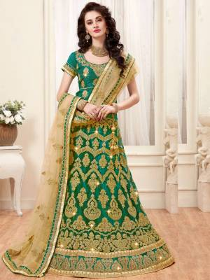 Here Is A Beautiful Designer Lehenga Choli In Green Color Paired With Beige Colored Dupatta. Its Blouse Is Fabricated On Art Silk Paired With Net Fabricated Dupatta. It Is Beautified With Heavy Jari Embroidery. Buy This Designer Lehenga Choli Now.