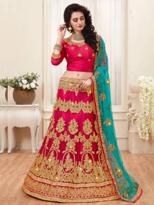 Shine Bright Wearing This Designer Lehenga Choli In Dark Pink Color Paired With Contrasting Turquoise Blue Colored Dupatta. Its Blouse Is Fabricated On Art Silk Paired With Net Fabricated Lehenga And Dupatta. It Is Light Weight And Also Easy To Carry Throughout The Gala.