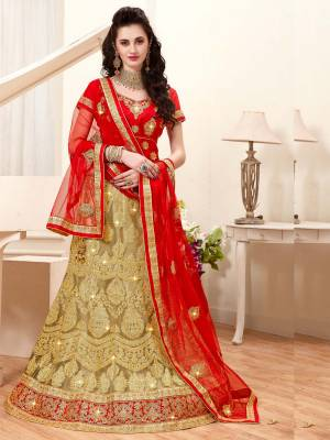 Celebrate The Upcoming Festive And Wedding Season with This Designer Lehenga Choli In Red Colored Blouse Paired With Beige Colored Lehenga And Red Colored Dupatta. This Lehenga Choli Is Beautified With Heavy Embroidery Which Will Give An Attractive Look Also It Is Easy To Carry Throughout The Gala. Buy Now.