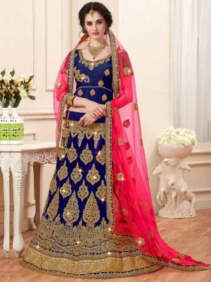 Dark Shades Always Enhance Your Beauty And Personality. So Grab This Designer Lehenga Choli In Dark Blue Color Paired With Contrasting Fuschia Pink Colored Dupatta. Its Blouse Is Fabricated On Art Silk Paired With Net Fabricated Lehenga And Dupatta. It HAs Heavy Jari Embroidery All Over It. Buy This Lehenga Choli Now.