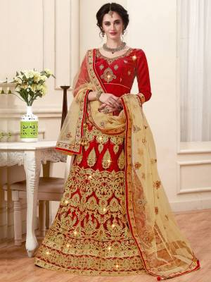 Catch All The Limelight At The Next Wedding You Attend With This Designer Lehenga Choli In Red Color Paired With BeigeColored Dupatta. Its Blouse Is Fabricated On Art Silk Paired With Net Fabricated Lehenga And Dupatta. It Has Attractive Jari Embroidery Making The Lehenga Choli Heavy.
