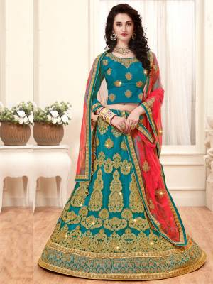 A Very Rare Combination Is Here In Lehenga Choli Is Here With This Designer Lehenga Choli In Turquoise  Blue Color Paired With Contrasting Peach Colored Dupatta. Its Blouse Is Fabricated On Art silk Paired With Net Fabricated Lehenga And Dupatta. Its Fabrics Ensures Superb Comfort All Day Long. Buy Now.