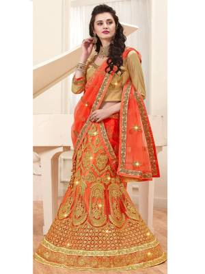 Orange Color Induces Perfect Summery Appeal To Any Outfit, So Grab This Designer Lehenga Choli In Golden Colored Blouse Paired With Orange Colored Lehenga And Dupatta. Its Blouse Is Fabricate On Gota Paired With Net Fabricated Lehenga And Dupatta. It Has Heavy Jari Embroidery All Over.  Buy Now.