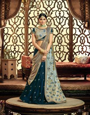 Bring out your gilded desires and adorn this gorgeously chic and elegant lehenga In Shades Of Blue, adorned with hanging bugle beads that?s going to make you look admirable.