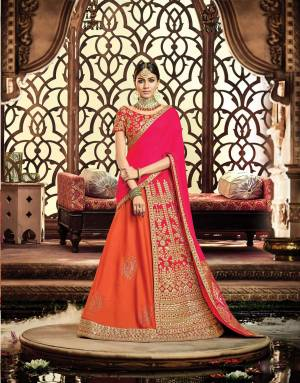 Make way for this queenly trend that's all set to make your regal soul satisfied With This Dark Pink And Orange Colored Lehenga. Pair the gota-enhanced lehenga with traditional jewelry and maangtika for an ethereal look.