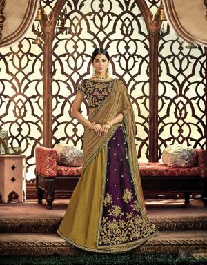 Appear like a true state of grace in this earthy and regal color combined two-layered lehenga In Purple And Olive Green Color. Adorn it with a traditional choker necklace to uplift the look.