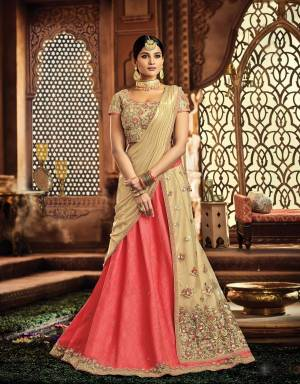 As regal as it gets, this lehenga in the most subtle tone of Pink and cream is an absolute royal-delight. Go subtle on your jewels or dress-up like a queen, you're meant to look gorgeous.