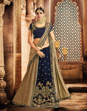 Weave a tale of grandeur in this navy blue lehenga bedecked with galloping horse motifs that's sure to take your ethnic-fashion game multiple notch higher.