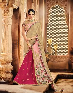 Look like an epitome of sheer granduer and feminine elegance in this pink floral ornamented lehenga . Add a vintage style choker necklace and statement earrings to add on to the magnificence.