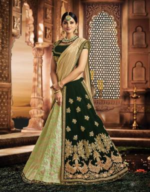 Exude a magnificent appeal and look radiant in this peacock-motif embellished two-layered lehenga in stunning shades of green and embrace the ethnic look in style.