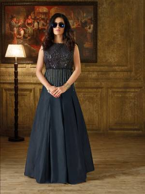 Enhance Your Personality, Wearing This Designer Floor Length Gown In Navy Blue Color With Imported Base Fabric Beautified With Embellishments Pipe Work And Also With 3D Yoke Fabric. Buy This Gown Now.